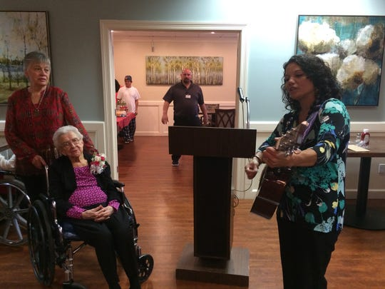 NHC Healthcare staffers honored resident Eva Fyke with a birthday celebration that included Happy Birthday sung to guitar.