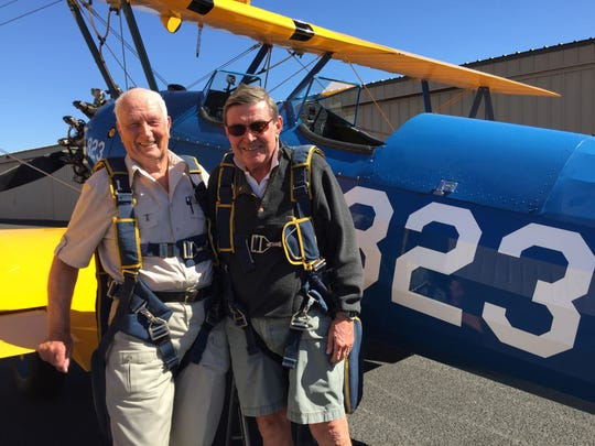 From left, Allan McNeely and Tom Ackland before taking off from Bermuda Dunes Airport in Ackland's 1943 Stearman biplane on Thursday, March 10, 2016