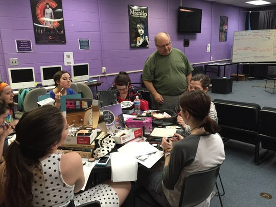 Theater and humanities students at the Shenandoah Valley Governor's School learn stage makeup techniques from Joe Hurt, a film and television makeup artist.