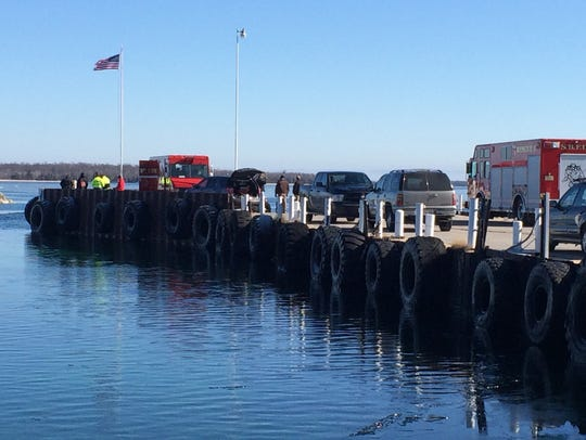 Emergency vehicles line the Northport dock on Friday,