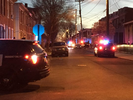 Wilmington police investigate a shooting at Taylor and North Pine streets on Friday.