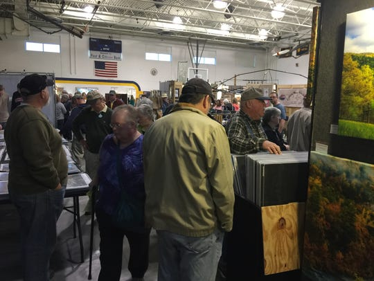 People pack the inside of the Highland County Public