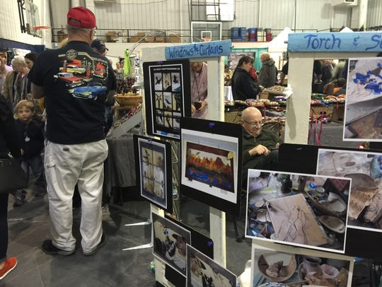 Vendors sell crafts, paintings and artwork at the Maple