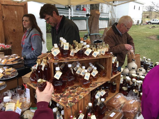 A table in downtown Monterey where a vendor sells syrup to visitors at the 2016 Maple Festival.