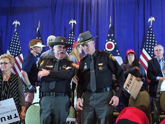 Republican Butler County Sheriff Richard Jones (left) talks to Democratic Hamilton County Sheriff Jim Neil at a Trump rally in West Chester in March 2016. Jones supports Trump, while Neil later said he only felt Trump was the best in the GOP field.