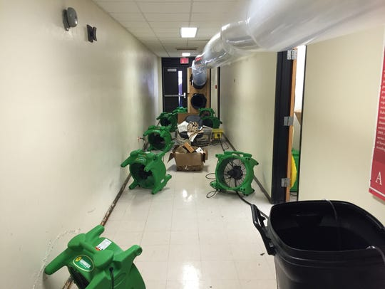 Fans circulate air at Adams Hall to keep walls dry