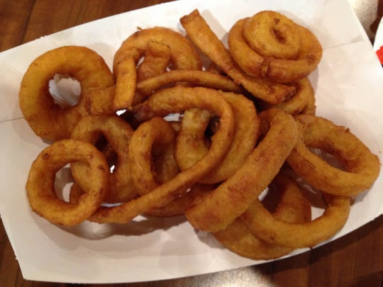 The generous portion of onion rings is one of several options for a side dish with sandwiches.