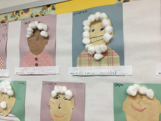 To celebrate the 100th day of school, kindergartners at McSwain Elementary School made portraits of themselves at 100 years old and wrote what they'll be doing when they are 100.
