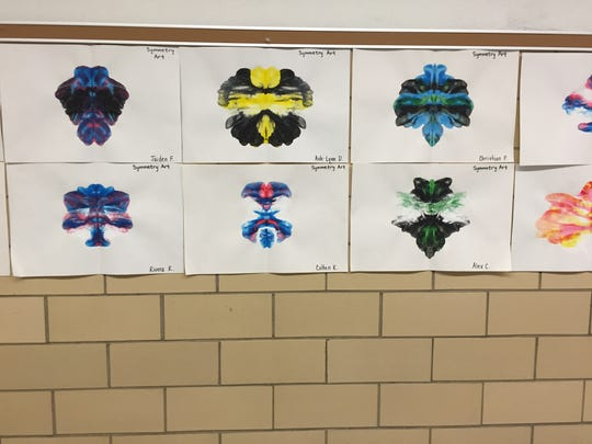 Student artwork hangs in the hallway at McSwain Elementary School. The lesson involved learning about symmetry.