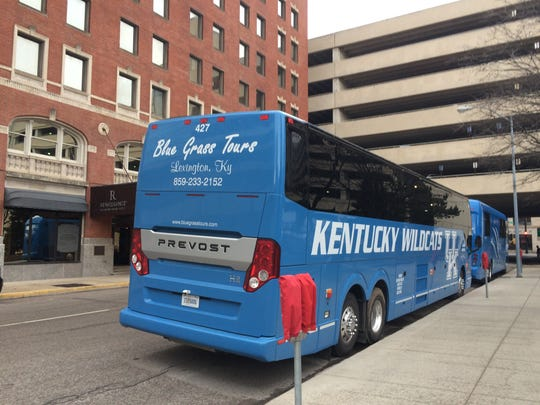 Two blue University of Kentucky buses pulled up Tuesday afternoon to the Renaissance Savery Hotel in downtown Des Moines.
