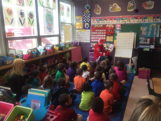 Prowlers read to children