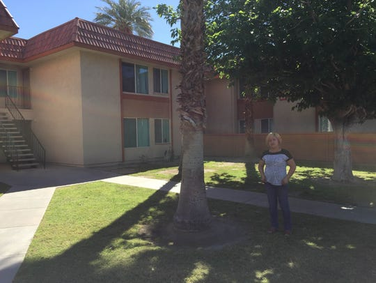 Leticia Valencia outside her unit at Summer Field Apartments