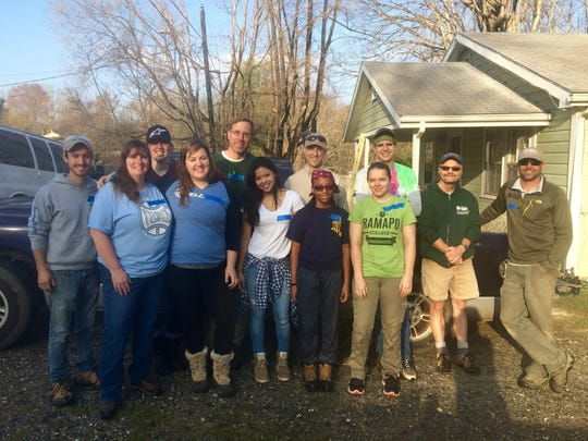 Students from Ramapo worked on home repairs for Asheville Area Habitat.