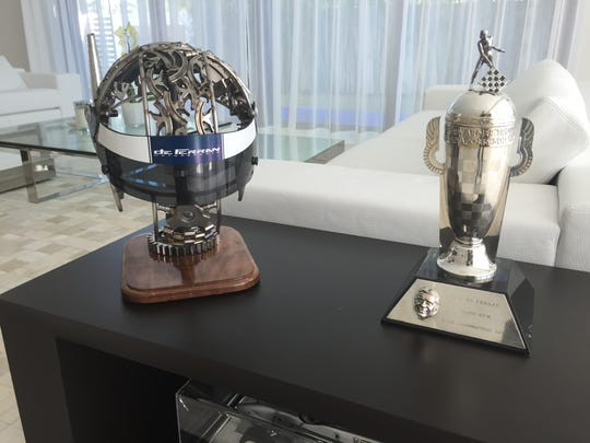 Gil de Ferran doesn't show off much from his racing days, but he keeps artwork presented by his former team alongside the miniature Borg-Warner Trophy in the living room.