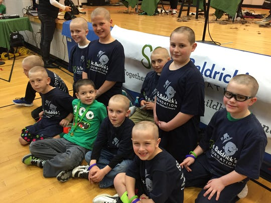 "Students from Jefferson School in Roxbury, members of ""Team Hudson,"" got their heads shaved to support Jefferson kindergarten student Hudson Stavrou (green shirt), during a St. Baldrick's Day fund-raiser Wednesday, March 17, 2016 at Kennedy School in Roxbury. The students raised about $15,000 this year. Hudson is in remission from Hodgkin's Lymphoma."