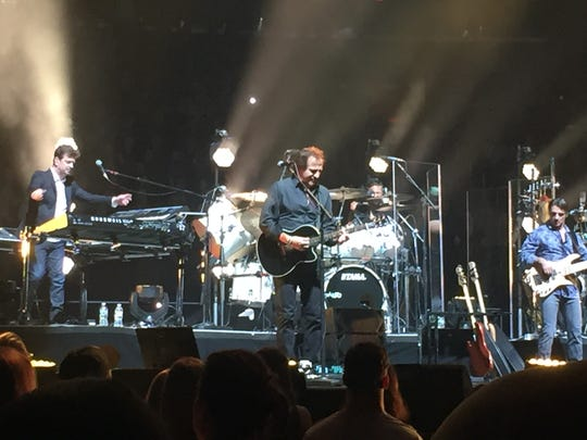 Millbrook resident Tommy Byrnes performs Tuesday night at Madison Square Garden with Billy Joel. At right is part-time Columbia County resident Andy Cichon on Bass.