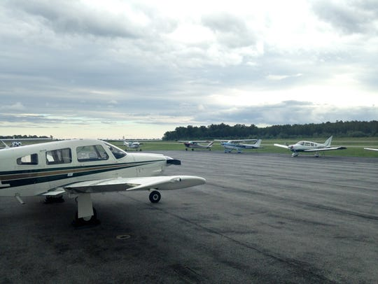 Recreational aircraft sit in a Canandaigua airport
