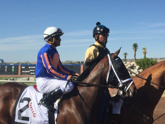 Rider Javier Castellano, left, rode Thrilled to victory in The Plum Pretty thoroughbred stakes.