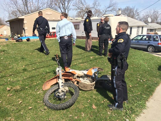 A man suspected in a robbery was apprehended by Des Moines Police after leading them on a chase while riding a dirt bike Monday, March 21, 2016.