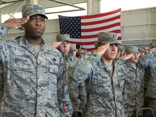 Barksdale Air Force Base airmen stand at attention during the singing of the National Anthem