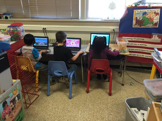 Four years olds work on computers at the Wayne Hills