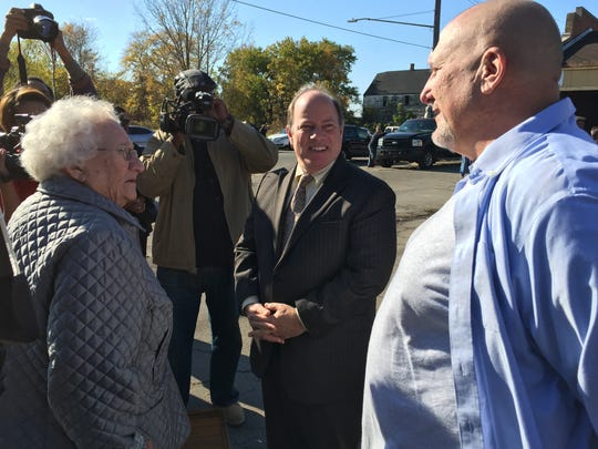 Gary Wozniak (right), founder and president of RecoveryPark, introduces Mayor Mike Duggan (center) to his mother, Bernadine Wozniak, at the  announcement Monday of city support for Wozniak's RecoveryPark urban agriculture project.