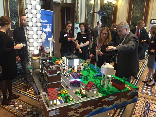 Soren Hvilshoj of the engineering consulting firm Ramboll explains the sustainable water system of a model town made out of Legos at the White House Water Summit on Tuesday. Denmark's Nature Agency prepared the display to highlight the country's efforts to reuse wastewater and use water sustainably.
