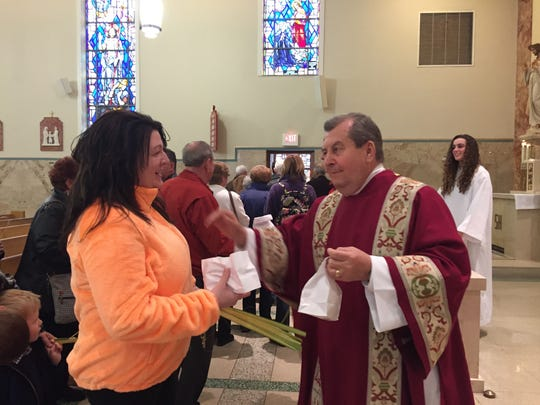 Deacon Alex Punchello distributed complimentary loaves