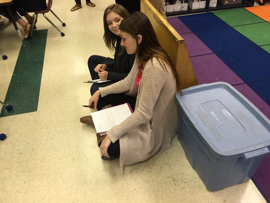 James Madison University education majors watch and take notes as they observe their peers lead a lesson on literacy for kindergarteners. Their peers will use the notes to adjust lesson plans.