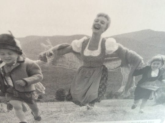 """A photo from the CD booklet for """"Something Good: Songs of Rodgers & Hammerstein"""" shows Broadway star Mary Martin and 5-year-old Elisabeth von Trapp (right) running in a field in Stowe."""