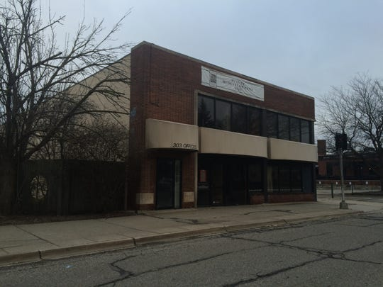 """The former East Lansing State Bank building known as the """"little bank"""" on Abbot , pictured here on Friday, March 25, 2016, is set for demolition."""