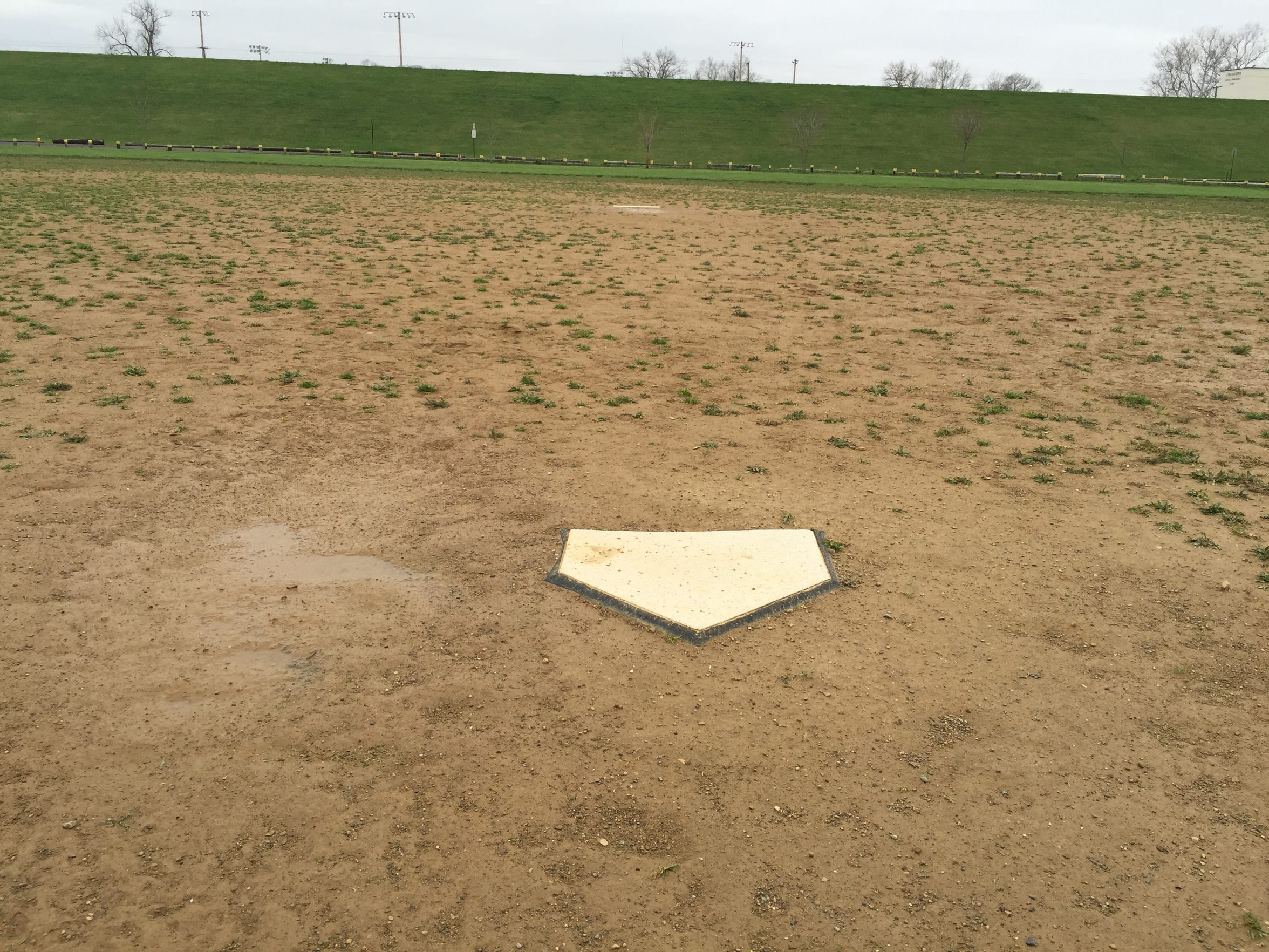 The conditions of Field G in the Yoctangee Park Annex — the same diamond Chillicothe's softball program called home — are shown after a rain storm. Standing water, no outfield fence, patches of grass on a dirt infield and no dugouts were frequent obstacles for the Cavaliers.