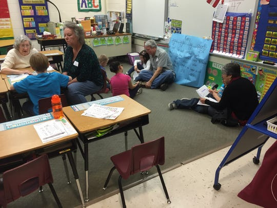 First graders read to grandparents on Grandparents'