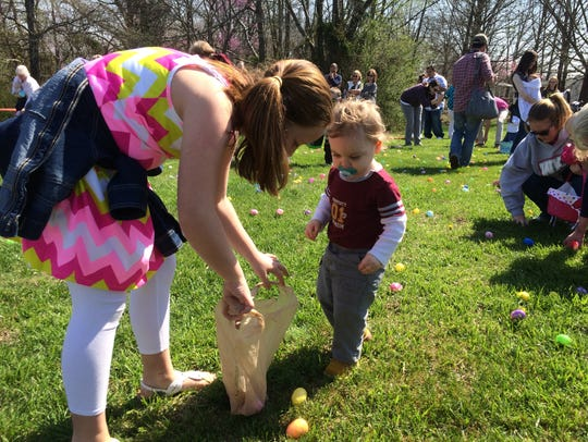 Parents helped their children round up Easter Eggs