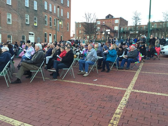 About 150 people gathered in the Brickyard for the Easter morning Sunrise Service.