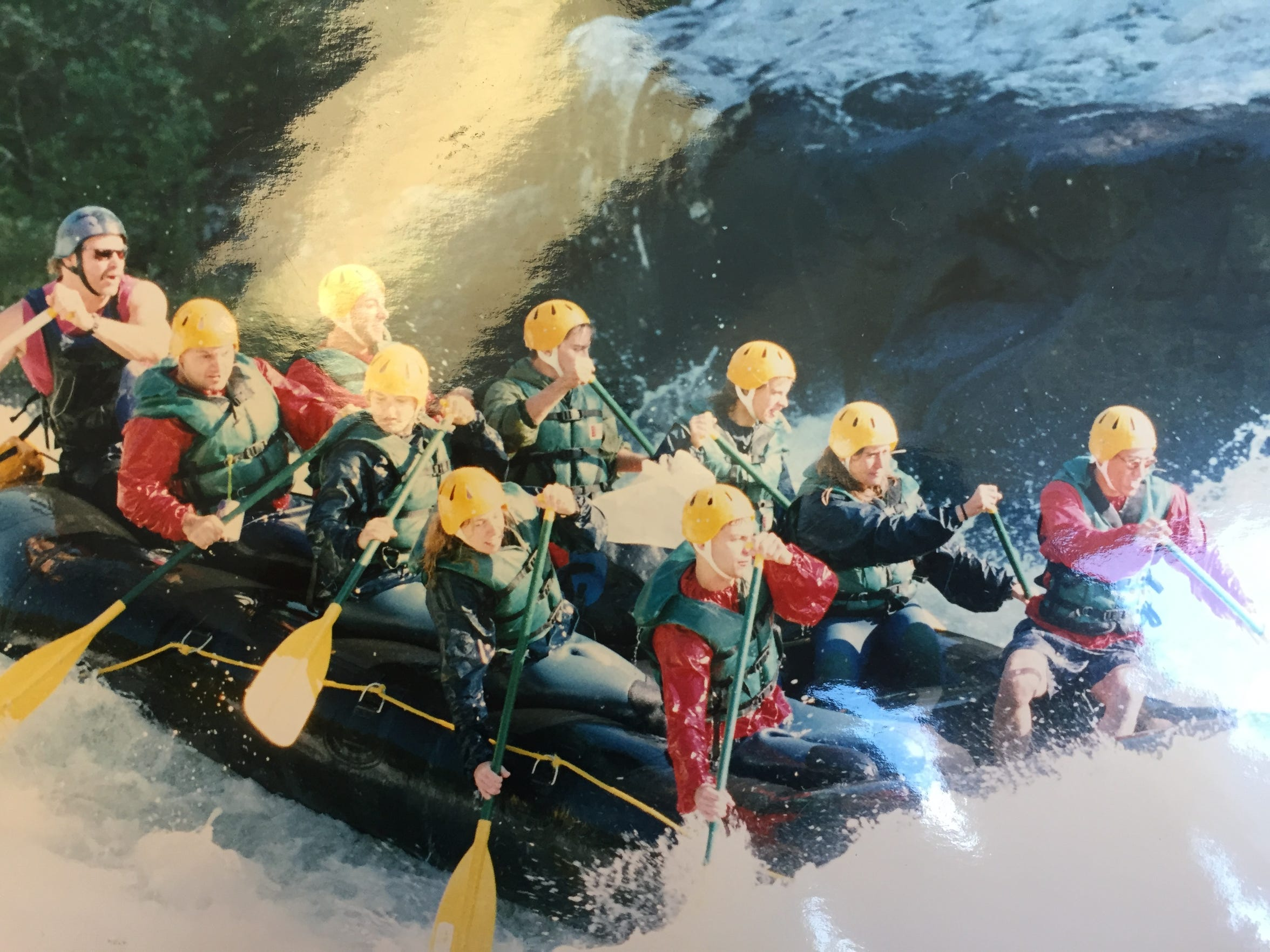 Sitting in the back of the raft is David Paulk, aka Bigwave Dave. Paulk was a whitewater rafting guide for 25 years.