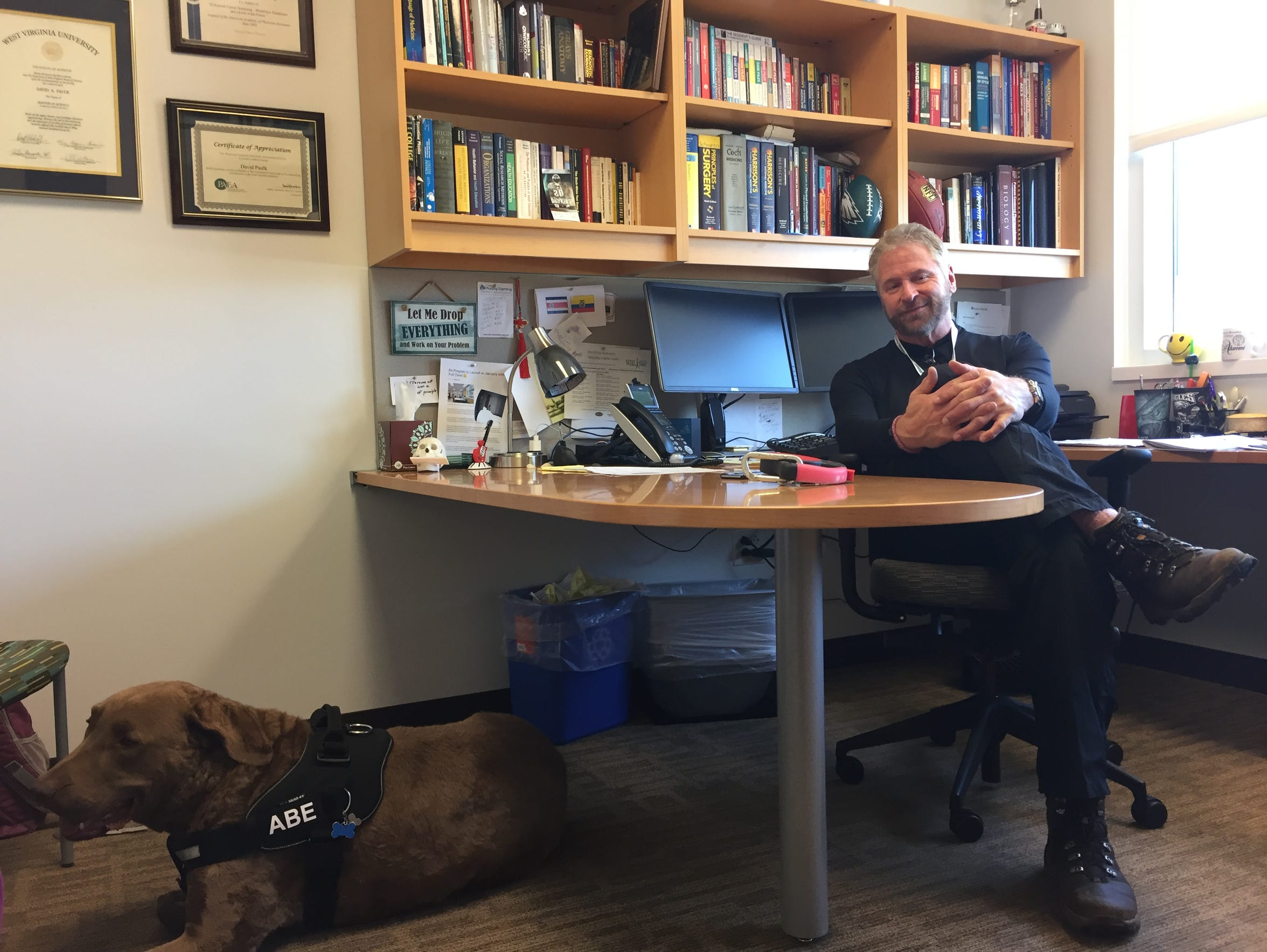 David Paulk and his dog, Abe, in his office at Mary