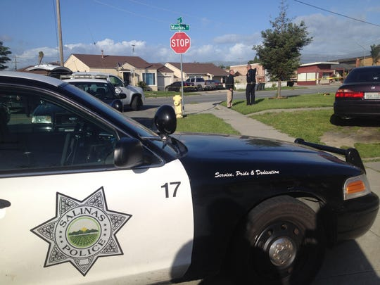 Salinas police respond to the scene of a drive-by shooting on Market Street Monday afternoon.