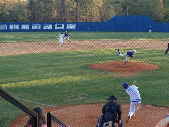 Jackson Christian's Carter Holt hits a two-run single to right in the Eagles' 15-4 win over Riverside.