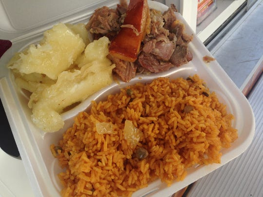 Yucca, roast pork with crispy skin and yellow rice from Famous Corner, a food truck in Cape Coral.