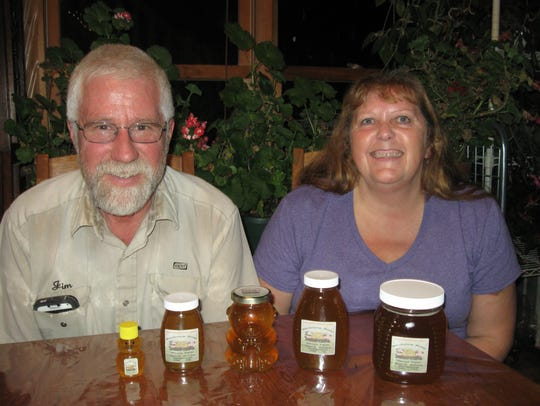 Jim and Karen Hesprich of Waupun with their honey offerings.