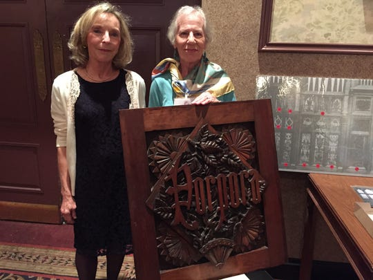 Society for the Preservation of Music Hall members Kathleen Janson, left, and Karen McKim, executive director of the Corbett Foundation, with a recovered organ panel.