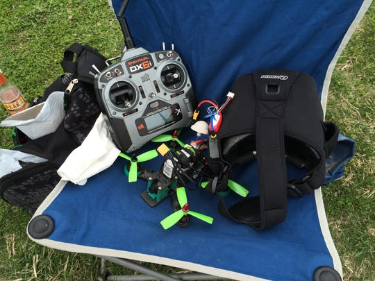 A controller, drone and video headset sit on a chair during a drone race in Ankeny Saturday, March 26, 2016.