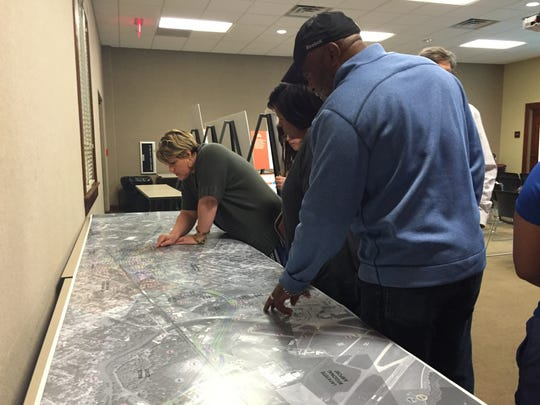 Sterling Grove Historic District residents look over a map of the proposed I-49 connector in Lafayette, March 30, 2016.