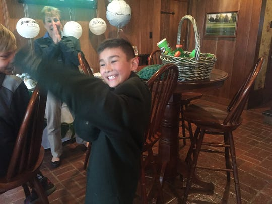 Charlie Danuloff is swimming in the Masters-inspired green sports jacket presented to him during his surprise send-off party Wednesday. Charlie is competing Sunday in the national Drive, Chip and Putt skills contest at Augusta National in Georgia as a lead-in to the Masters Tournament.
