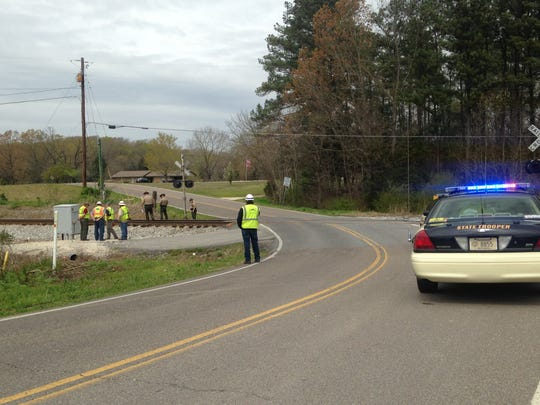Tennessee Highway Patrol troopers and others investigate