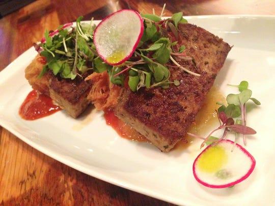 Union 50's kimchi meatloaf with apple yuzu jam on potato