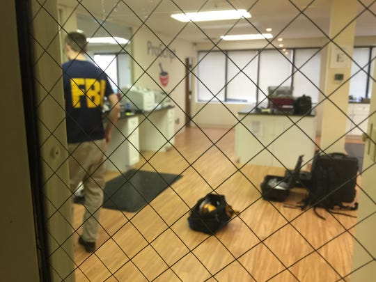 At least four federal agents could be seen inside ProScript, a pharmacy company located inside an office building at 9292 N. Meridian on Indianapolis' north side, on Thursday. The Ziad Khader is connected to the business. Agents were seen at his home in Carmel, too.