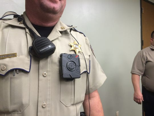 Patrol Deputy Shannon Deshotel shows off the Taser