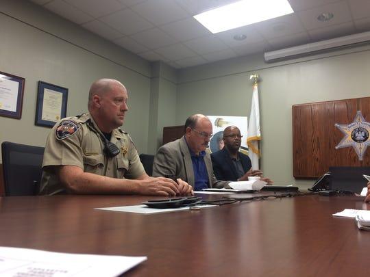 Patrol Deputy Shannon Deshotel, Chief Deputy Art LeBreton and Capt. John Babin speak with the media about their new body cameras.